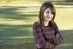 8167700-enfant-confiant-11-ans-regardant-la-camera-avec-les-bras-croises