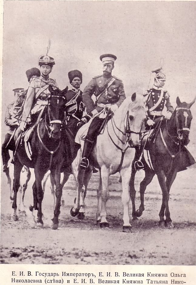 Tsar Nicholas II riding with two of his daughters Olga and Tatiana. Both daughters can be seen in full military dress for their corresponding regiments that they are Colonel in Chief of.  This photograph may have been taken in August of 1913.