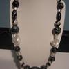 collier noir blanc vendu