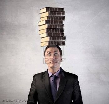 8999987-man-with-stack-of-books-on-his-head