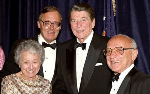 Free-market economics meets free-market policies at The Heritage Foundation's Tenth Anniversary dinner in 1983. Nobel Laureate Milton Friedman and his wife Rose with President Ronald Reagan and Heritage President Ed Feulner.
