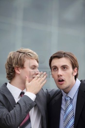 8227724-businessman-whispering-into-his-colleague-s-ear