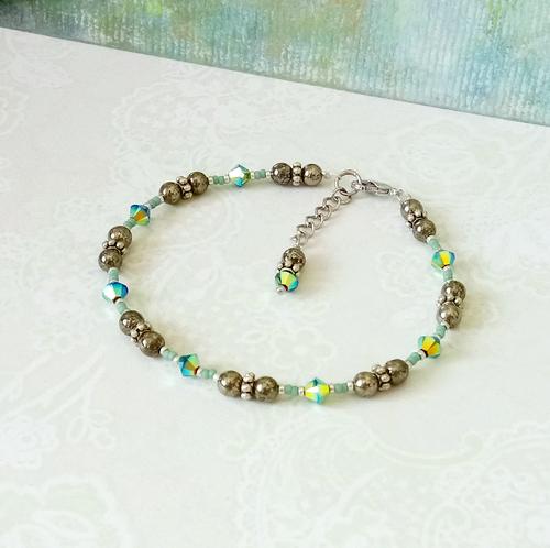 Bracelet pierre de pyrite 4mm et cristal de Swarovski / Plaqué argent