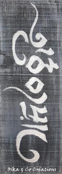 Caligraphie tibétaine sur planche de bois vieillie Respire