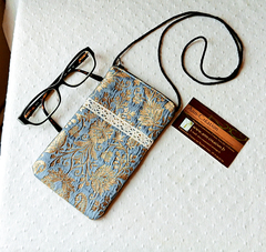 Etuis tonalités bleu, vert et or pour téléphone, lunettes, crayons de maquillage