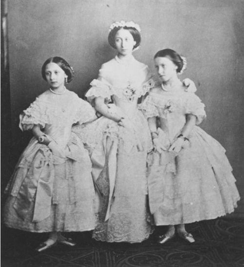 Tea Time at Winter Palace: Princess Louise, Princess Alice & Princess Helena of England in the dresses they wore at the marriage of their eldest sister Princess Victoria to Frederich III, January 25 1858.: