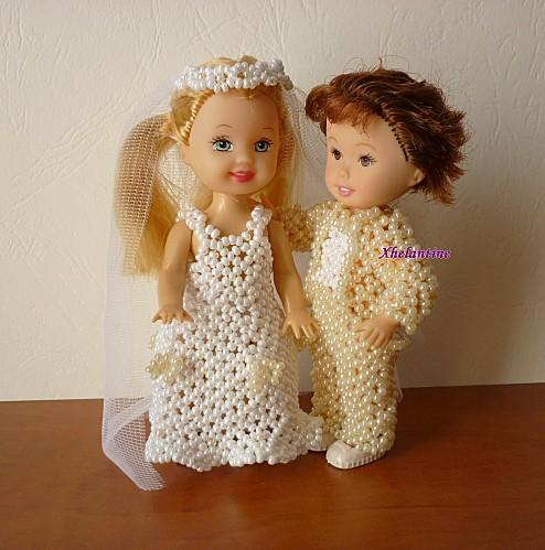 couple de maries habilles de perles 1