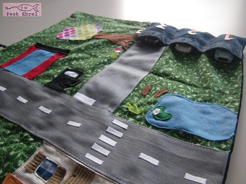 Le tapis/garage à voitures ou Cosy car caddy