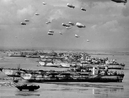 - 6 Juin 1944, Grand Show à l'Américaine « Acte I » de la Société du Spectacle : Les acteurs, par milliers, meurent pour de vrai !