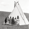 Cheyenne American Horse beside his tepee with his two wives, daughters, and son. Montana. 1901.
