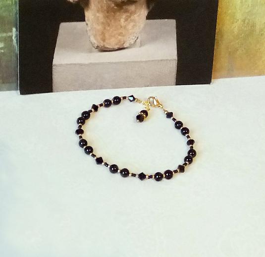 Bracelet pierre Onyx noir 4mm et cristal de Swarovski / laiton doré