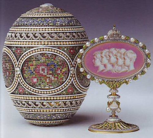 The Mosaic egg, also belonging in the Royal Collection was considered one of Faberge's most sophisticated creations. It was gifted to the Empress Alexandra by her husband, Tsar Nicholas II in 1914. However, due to the original invoice being destroyed, the exact cost of this egg is unknown. The five portraits on the 'surprise' are of OTMA and Alexei, their children.  Like the Colonnade egg, this one was also confiscated by the provisional government in 1917, then sold by the  Antikvariat in 1933 and then purchased by King George V in 1933 for around £250.  Mosaic Egg