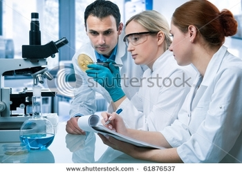 stock-photo-group-of-scientists-working-at-the-laboratory-61876537