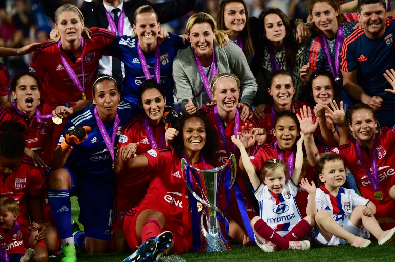 Olympique Lyonnais' players celebrate after winning the UEFA Women's Champions League Final football match VFL Wolfsburg vs Lyon at the Citta del Tricolore stadium in Reggio Emilia on May 26, 2016. Lyon won the final in the penalty shoot-out (4-3; 1-1)  / AFP PHOTO / GIUSEPPE CACACE