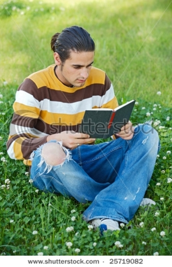 stock-photo-casual-boy-reading-a-book-in-the-green-grass-25719082