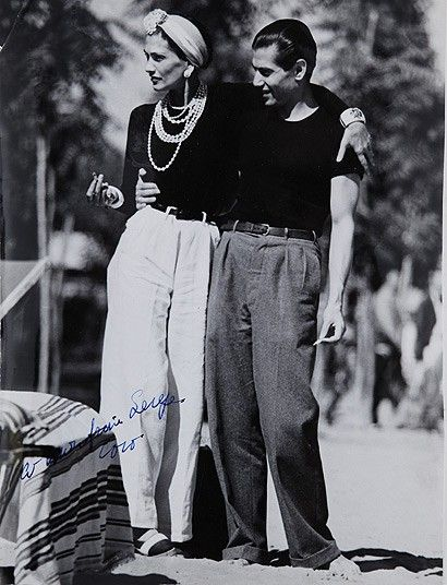 Coco Chanel with Serge Lifar, the principal dancer of Diaghilev's Ballets Russes during its final years in the late 1920's.  black and white vintage fashion photo: