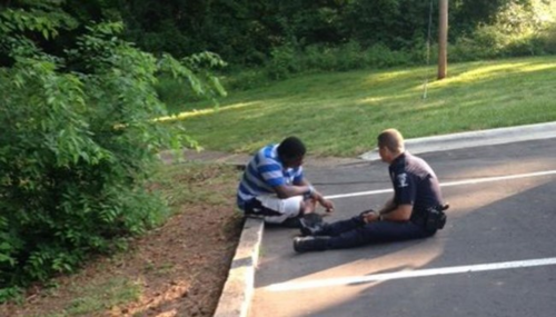 This Photo of a Cop Helping a Teen with Autism Went Viral.