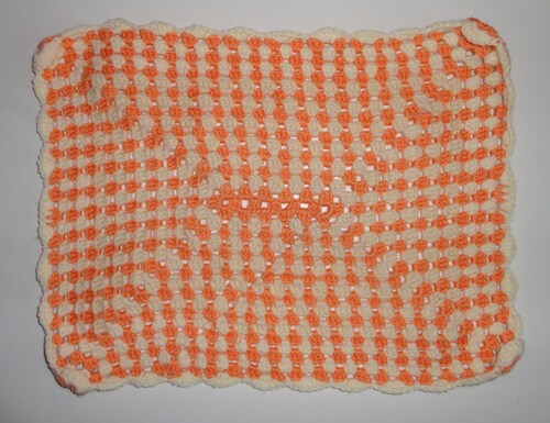 un granny rectangle ou couverture pour poupée