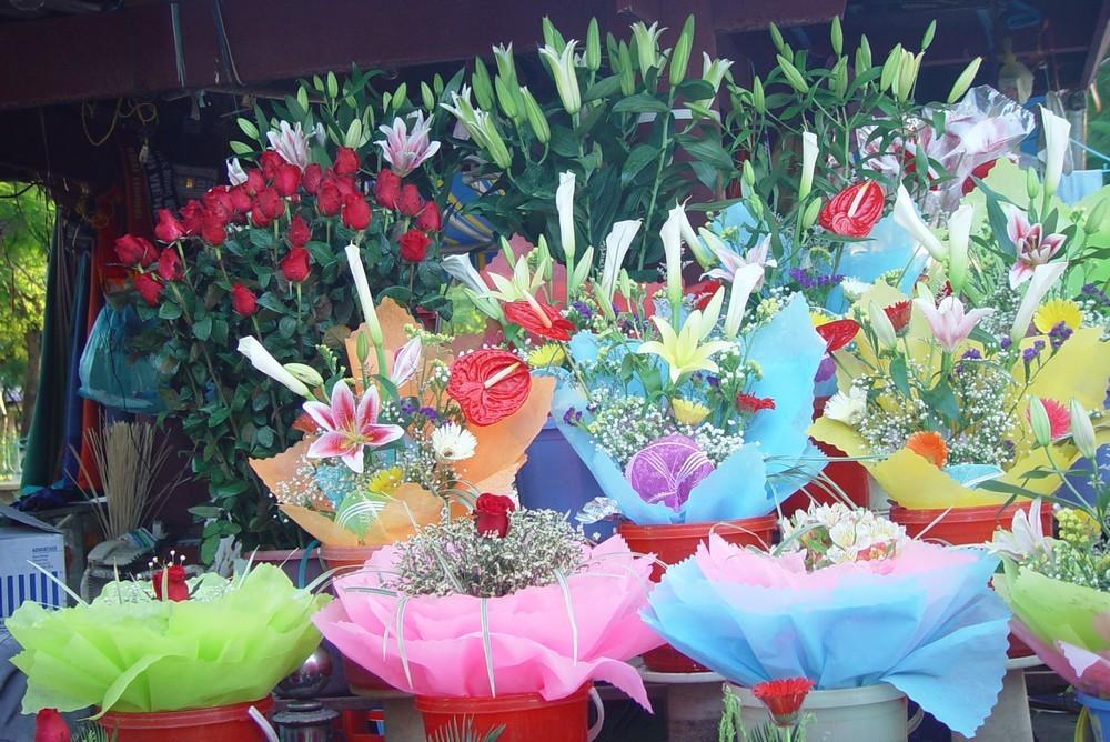 Vendeuses de fleurs au Vietnam...
