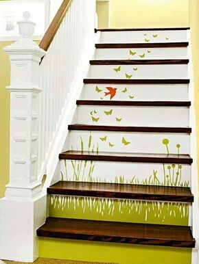 Stair decoration of wild flowers, birds and butterflies. So pretty.