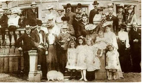 The Imperial family visiting Denmark: 1903.  Standing in front of Alexandra Feodorovna are Grand Duchess Tatiana, Princess Ella of Hesse, Grand Duchess Olga, Grand Duchess Anastasia (sitting on the wall) and Grand Duchess Maria next to her mother.