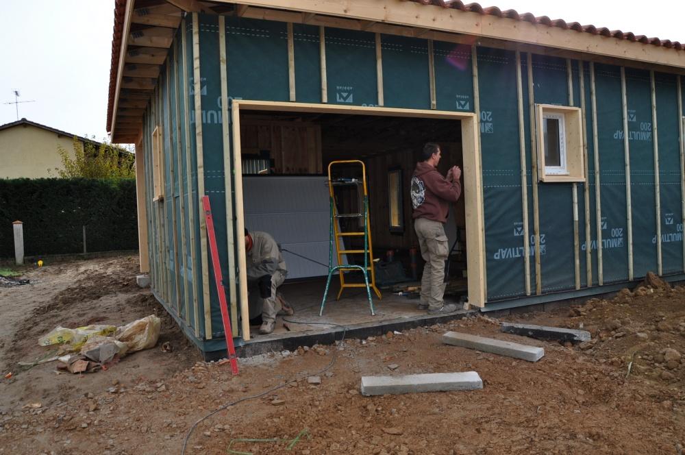 Remplacer porte de garage par baie vitre affordable duune for Remplacer une porte de garage par une fenetre