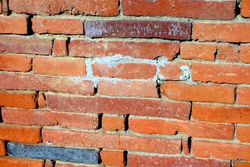 Vieux mur en brique de terre cuite