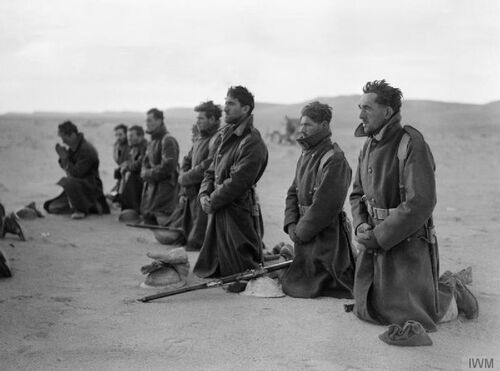"""Free French soldiers attend a mass at sunrise during the siege of Bardia in Libya, December 1940."""