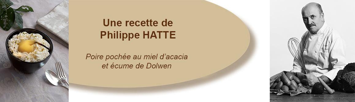 Poire pochée au miel d'acacia et écume de Dolwen