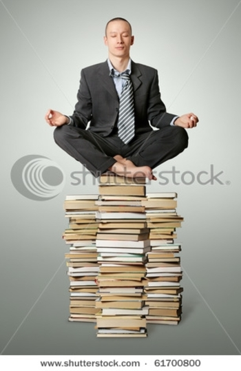 stock-photo-businessman-in-lotus-pose-with-many-books-near-isolated-on-white-61700800