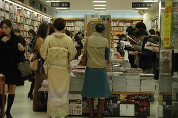 NRT Tokyo - Ginza shopping area people reading magazines in a bookshop 3008x2000