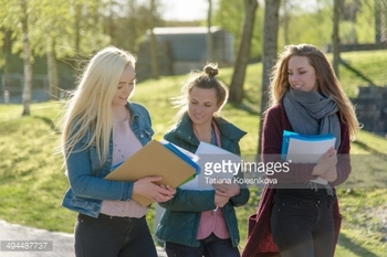 494487737-student-girls-walking-outside-university-gettyimages