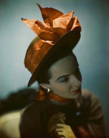 1946  photo by Constantin Joffe    Model is wearing Lilly Daché's toast-colored bare-browed sailor hat with a tangerine bow.: