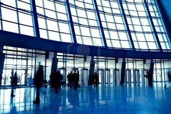 5875826-people-in-wide-blue-enter-hall-window-in-exposition-center-left-copmosition
