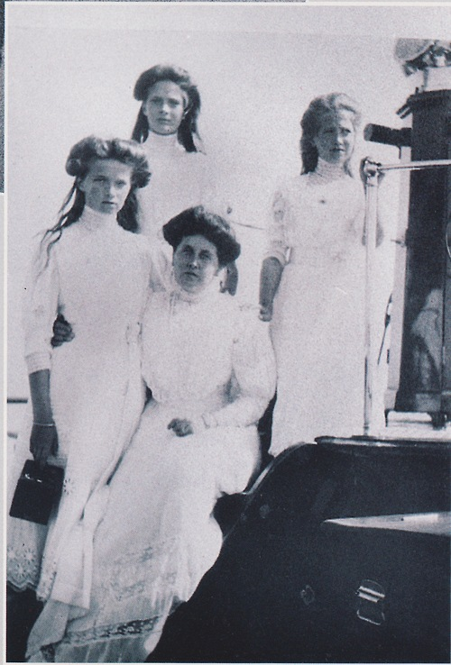Grand Duchesses Olga, Tatiana and Maria with Anna Vyrubova aboard the Standart: 1908.  My scan.