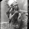 An Arapaho man with gun. 1898. Wyoming. Photo by Baker & Johnston