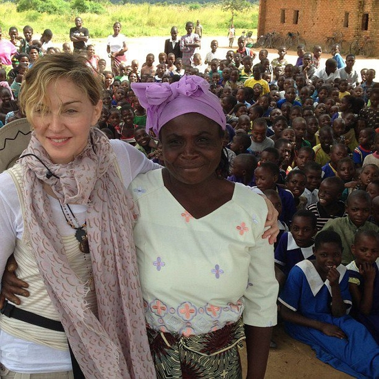 With a Woman from Nijiti Village in Malawi where we have built 10 schools with Build On! Equal atten