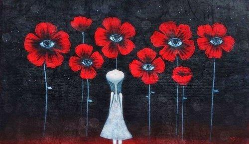 femme-avec-des-fleurs-detendant-son-esprit-500x289