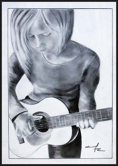 f ♦ Une jeune guitariste