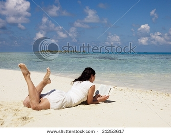 stock-photo-woman-reading-book-at-sandy-beach-31253617