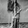Ute medicine man, as Johnson (Canalla), holding a staff adorned with two human scalps 1870-80