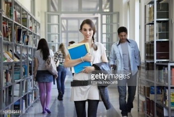 106349441-library-corridor-plated-hair-portrait-books-gettyimages