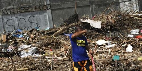 The Philippines the survivors bury their deaths and call in for help