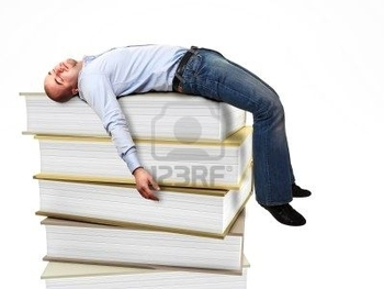8396198-portrait-of-stressed-man-sleeping-on-a-3d-book-pile