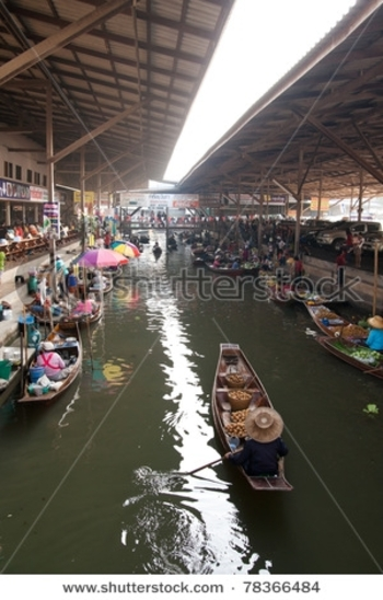 stock-photo-nakhon-pathom-february-wooden-boats-ferrying-people-at-amphawa-floating-market-on-februa
