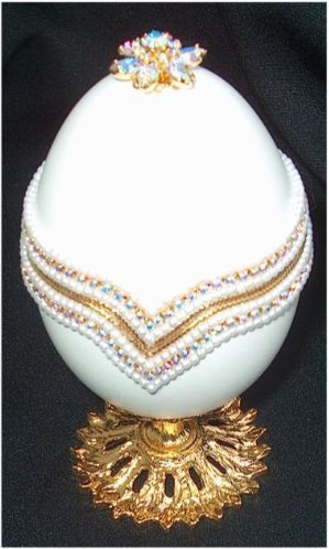 The 'Gatchina Palace' Faberge Egg - made in 1901 for Tzar Nicholas. The egg opens to reveal a miniature gold replica of the palace at Gatchina: