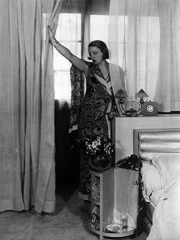 Artist Tamara Lempicka in her bedroom, rue Méchain, 1930s: