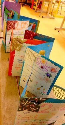 Productions élèves CM2 - carte de vœux Noël première page avec texte de vœux en anglais: