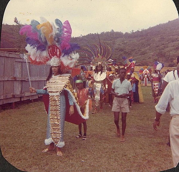 627px-GrenadaCarnival1965FeatheredHeaddresses