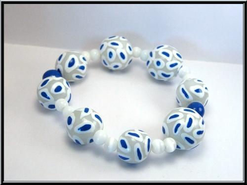 Bracelet élastique perle Fimo et oeil de chat.